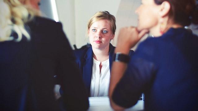 woman looking at customers