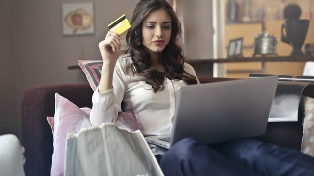 girl using debt CARD