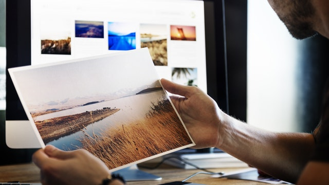 man looking over images